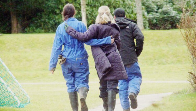3 people walking on a path at Beannachar community