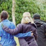 people walking arms in arm