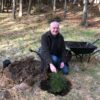 Mark in the woods planting a tree