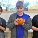 3 boys with carved pumpkins